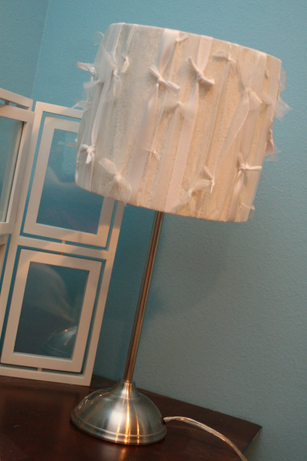 Lamp shade makeover ribbon and lace lamp to cover with ribbon all i did was cut enough length of ribbon to go around the lamp and tie in a double knot in the front do this about fifty times aloadofball Choice Image